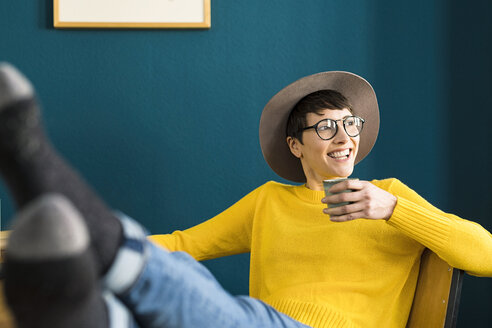 happy short-haired entrepreneur woman in home office holding coffee mug - SBOF01755