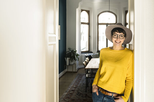 Portrait of smiling stylish woman at home - SBOF01776