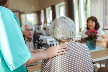 Female nurse taking care of senior people in nursing home - MASF11168
