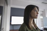 Pensive businesswoman looking away - HEROF23145