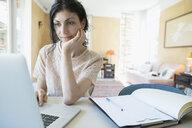 Woman at laptop working at home - HEROF23373