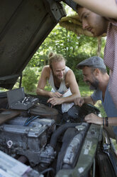 Young male friends fixing car engine - HEROF23391