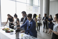 Business people at conference buffet table - HEROF23535