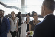 Business people talking, networking and eating at conference - HEROF23538