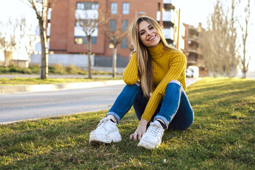 Portrait of smiling young woman wearing yellow turtleneck pullover - ACPF00464