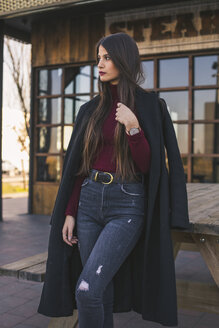 Fashionable teenage girl wearing black coat - ACPF00466