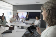 Businesswoman leading conference room meeting - HEROF23808