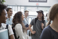 College students talking and laughing - HEROF24075