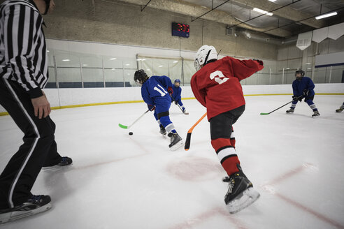 Boy ice hockey players playing on ice hockey rink - HEROF24111