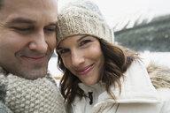 Portrait of smiling couple wearing warm clothing - HEROF24228