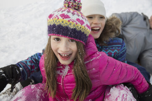 Portrait of smiling girls playing in snow - HEROF24246
