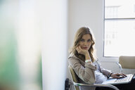 Portrait of confident businesswoman working at laptop - HEROF24261