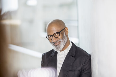 Portrait of bald mature businessman with grey beard wearing glasses - FMKF05407