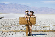 USA, California, Death Valley National Park, Badwater Basin, portrait of happy mother and baby girl - GEMF02853