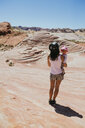 USA, Nevada, Valley of Fire State Park, back view of mother and baby girl watching landscape - GEMF02859