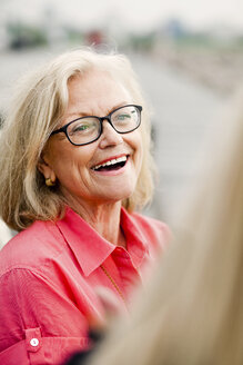 Close-up of cheerful senior woman outdoors - ASTF03739