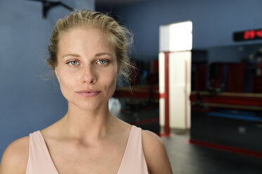Portrait of confident young blond woman in a gym - ECPF00524