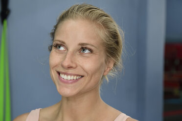 Portrait of smiling young blond woman in a gym - ECPF00527