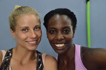Portrait of two happy women in gym - ECPF00539