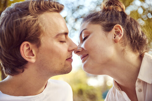 Young couple in love kissing at a park - JHAF00056