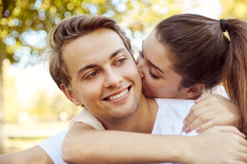 Happy young couple in love kissing at a park - JHAF00065