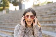 Portrait of a playful young woman wearing sunglasses - AFVF02441