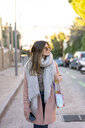 Young woman in the city looking around - AFVF02453