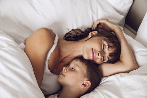 Mother and son cuddling in bed - MCF00042