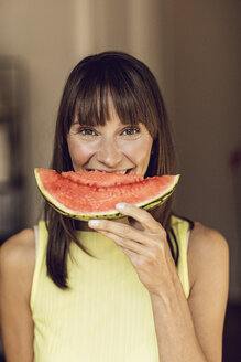 Beautiful woman eating slice of watermelon - MCF00069