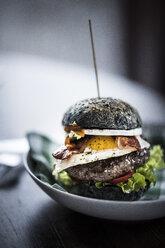 Black hamburger with egg and bacon - MJRF00071