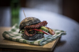 Black burger with fried octopus and vegetables - MJRF00074