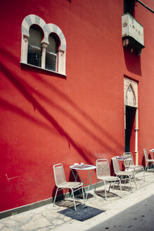 Chairs and table at empty sidewalk cafe - ASTF04691