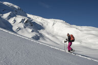 Switzerland, Bagnes, Cabane Marcel Brunet, Mont Rogneux, woman ski touring in the mountains - ALRF01386
