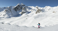 Switzerland, Grand Saint Bernard Pass, Pain de Sucre, Mont Fourchon, woman ski touring in the mountains - ALRF01404