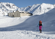 Switzerland, Great St Bernard Hospice, woman ski touring in the mountains - ALRF01407