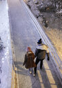 Top view of young couple on an ice rink at night - ZEDF01885