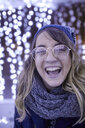 Portrait of laughing young woman in winter decoration - ZEDF01906