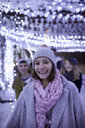 Portrait of happy young woman in winter decoration - ZEDF01909