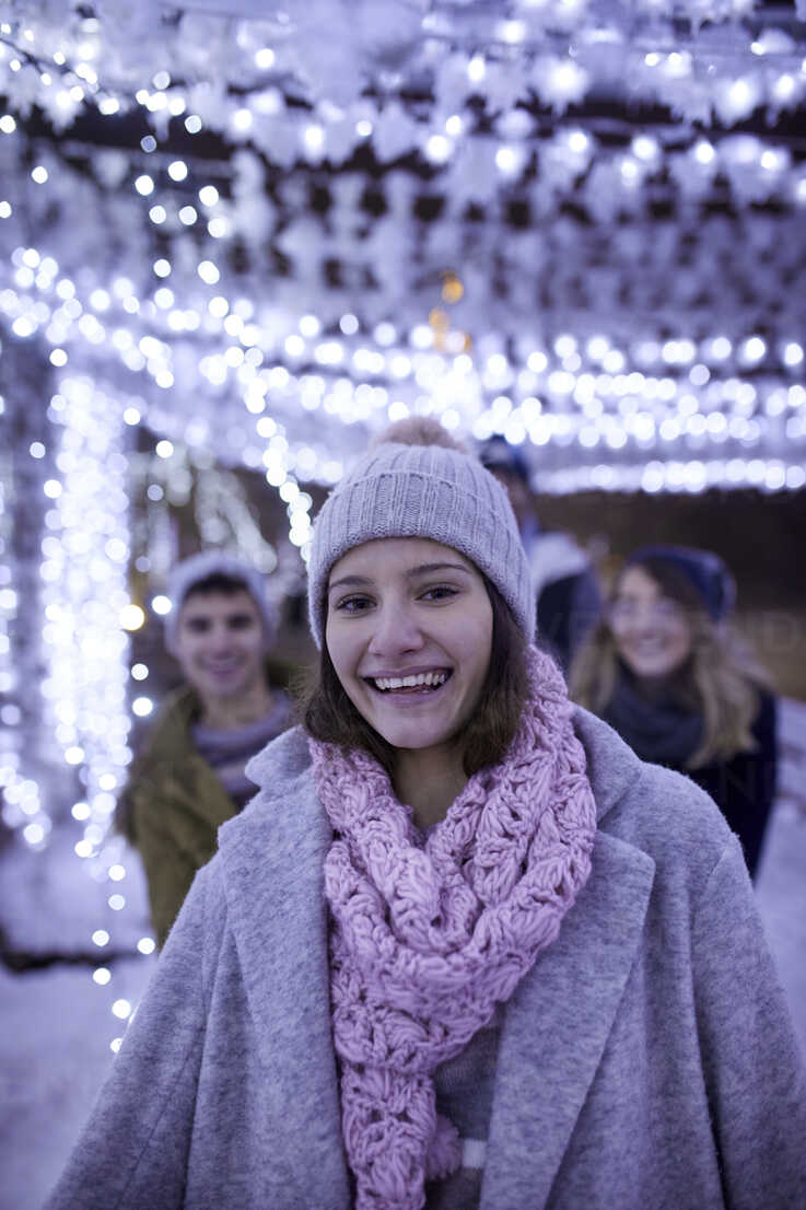 Portrait of happy young woman in winter decoration - ZEDF01909 - Zeljko Dangubic/Westend61