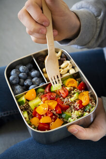 Lunchbox with quinoa salad with tomato and cucumber, blue berry and trail mix - LVF07829