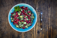 Bowl of bulgur wheat salad with cucumber, herbs, pomegranate seed and parsley - LVF07832