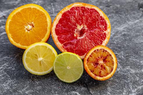 Sliced citrus fruits on slate - SARF04126