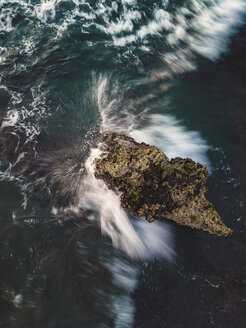 Indonesia, Bali, Batu Bolong beach, Aerial view of an ocean wave at a rock - KNTF02704