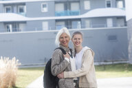 Portrait of smiling mother and adult daughter outdoors - SGF02320