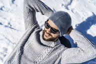 Happy man relaxing in winter - DIGF05924