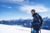 Germany, Bavaria, Brauneck, man on a ski tour in winter in the mountains - DIGF05951