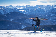Germany, Bavaria, Brauneck, man on a ski tour in winter in the mountains - DIGF05963