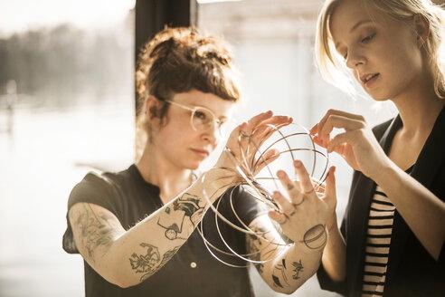 Designer adjusting ring-shaped object - MJRF00078
