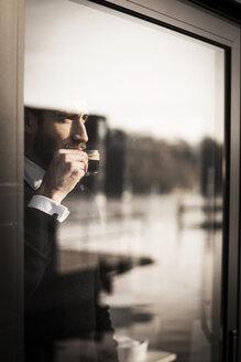 Businessman enjoying his coffee - MJRF00081