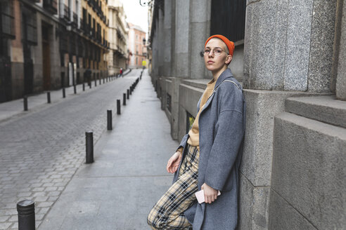 Spain, Madrid, thoughtful portrait of a young woman in the city - WPEF01368